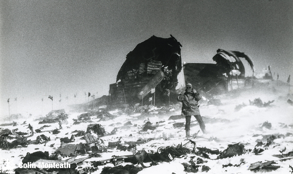 New Zealand policeman, blowing snow, Air New Zealand crash site, above Lewis Bay, Ross Island, November 1979.