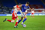 Cardiff City's Perry Ng (38) dribbles past Millwall's Scott Malone (14) during the EFL Sky Bet Championship match between Cardiff City and Millwall at the Cardiff City Stadium, Cardiff, Wales on 30 January 2021.