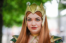 © Licensed to London News Pictures. 28/05/2017. London, UK. A girl dressed as Mera from Aqua Man at MCM Comic Con taking place at Excel in East London.  The three day event celebrates popular comic books, anime, games, television and movies.  Many attendees take the opportunity to dress as their favourite characters.    Photo credit : Stephen Chung/LNP