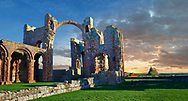 The Anglo Saxon Romanesque Lindisfarne Abbey ruins at sunset,  Holy Island, Lindisfarne, Northumbria, England .<br /> <br /> Visit our MEDIEVAL PHOTO COLLECTIONS for more   photos  to download or buy as prints https://funkystock.photoshelter.com/gallery-collection/Medieval-Middle-Ages-Historic-Places-Arcaeological-Sites-Pictures-Images-of/C0000B5ZA54_WD0s