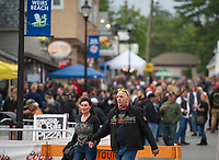 "A good crowd fills the street at the block party style ""Biketemberfest"" early Saturday evening while the night was still young.  (Karen Bobotas/for the Laconia Daily Sun)"
