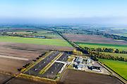 Nederland, Groningen, Gemeente Midden-Groningen, 04-11-2018; Aardgaswinningsinstallatie en gasbehandelingslocatie bij Kolham, nabij Slochteren. In 1959 werd bij Kolham voor het eerst aardgas ontdekt, de Slochter gasbel.<br /> Door aardbevingen getroffen gebied, bevingen die het gevolg zijn van de winning van aardgas.<br /> Natural gas extraction facility at Kolham, near Slochteren. In 1959, at Kolham, natural gas was discovered for the first time, the Slochter gas bubble.<br /> Earthquake-affected area, quakes resulting from the extraction of natural gas.<br /> <br /> luchtfoto (toeslag op standaard tarieven);<br /> aerial photo (additional fee required);<br /> copyright© foto/photo Siebe Swart