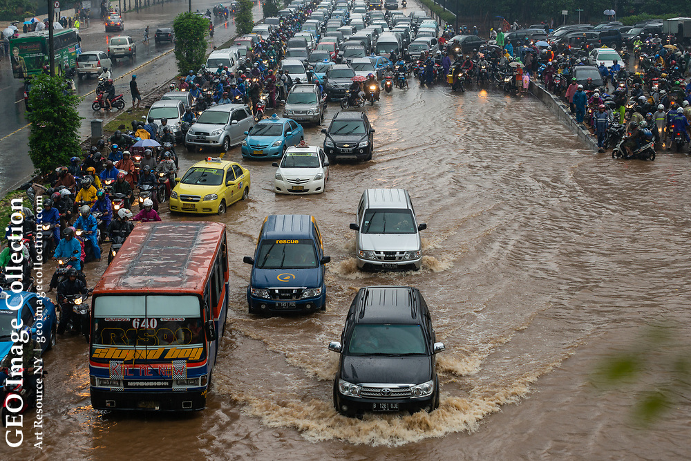 Record flooding in Jakarta, 20,000 evacuated. Traffic on a flooded street in the central business district. Indonesia