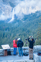 Image of photographers at the Tunnel View overlook. Bridalveil Falls and Yosemite Valley. Yosemite National Park.