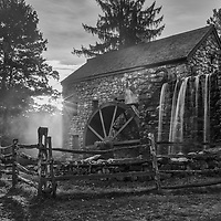 New England black and white photography of the iconic Wayside Inn Grist Mill in Sudbury, Massachusetts.<br />