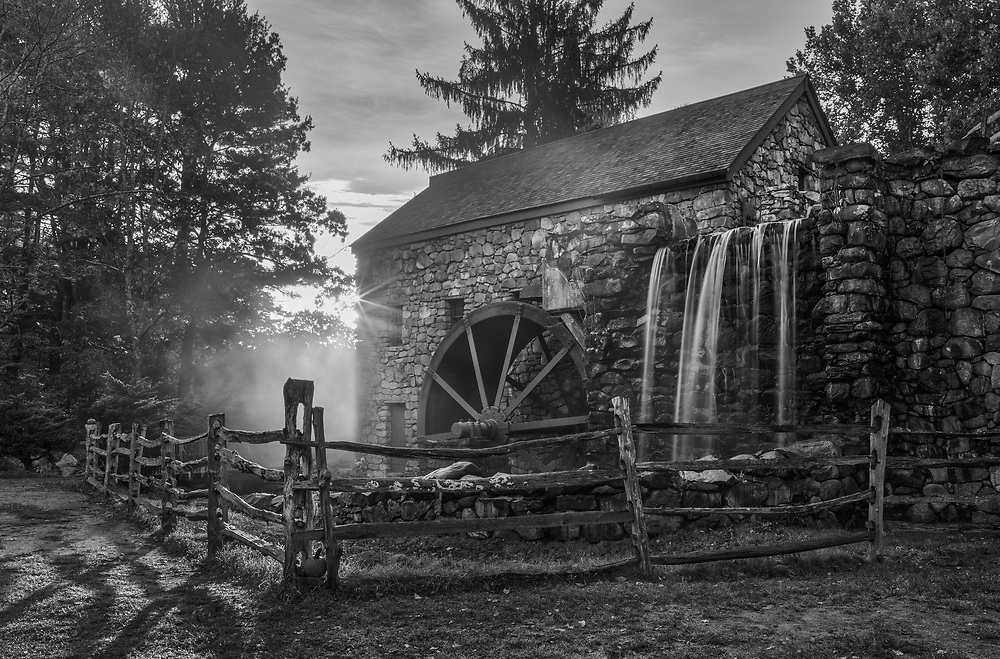 New England black and white photography of the iconic Wayside Inn Grist Mill in Sudbury, Massachusetts.<br /> <br /> Massachusetts b & w photography images are available as museum quality photo, canvas, acrylic, wood or metal prints. Wall art prints may be framed and matted to the individual liking and interior design decoration needs:<br /> <br /> https://juergen-roth.pixels.com/featured/new-england-black-and-white-photography-of-wayside-inn-grist-mill-juergen-roth.html<br /> <br /> Good light and happy photo making!<br /> <br /> My best,<br /> <br /> Juergen