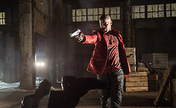 Bats (JAMIE FOXX) gets in a firefight within an abandoned rail yard as the crews gun deal goes bad in TriStar Pictures' BABY DRIVER.