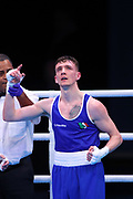 rendan Irvine of Ireland (bue) celebrates beating Istvan Szaka of Hungary (red) in the Men's Flyweight preliminaries during The Road to Tokyo European Olympic Boxing Qualification, Sunday, March 15, 2020, in London, United Kingdom. (Mitchell Gunn-ESPA-Images/Image of Sport)