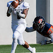 November 5, 2016 - Santa Ana, CA - Fullerton College Sophomore RB Phillip Butler (6) slips out of a tackle by Orange Coast College Freshman LB Bryce Garcia (59) for a touchdown in their 35-14 win