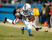 CHARLOTTE, NC - JAN 24:  Running back Jonathan Stewart #28 of the Carolina Panthers is tackled by cornerback Patrick Peterson #21 of the Arizona Cardinals during the NFC Championship game at Bank of America Stadium on January 24, 2016 in Charlotte, North Carolina.
