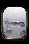 view from window of an airplane during a rainy day.