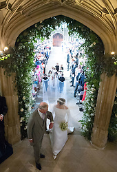 Meghan Markle walks up the aisle with the Prince of Wales at St George's Chapel at Windsor Castle during her wedding to Prince Harry.