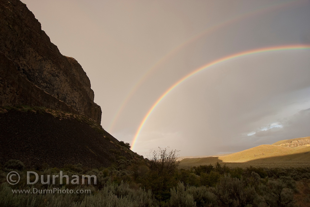 A double rainbow, photographed near Dutch Henry Falls - A preserve managed by The Nature Conservancy. High-desert, central Washington.