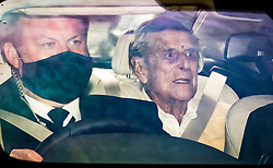 © Licensed to London News Pictures. 16/03/2021. London, UK. PRINCE PHILIP, THE DUKE OF EDINBURGH (right)  is driven from King Edward VII hospital in London. The Duke has spent a number of nights in hospital care after being admitted under doctors advice for an illness unrelated to COVID-19. Photo credit: Ben Cawthra/LNP