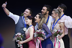 January 20, 2018 - Moscow, Russia - Ekaterina Bobrova and Dmitri Soloviev of Russia, left and silver medalists, Gabriella Papadakis and Guillaume Cizeron of France, center and gold medallists, and Alexandra Stepanova and Ivan Bukin of Russia, right and bronze medallists, pose for a selfie after the pairs ice dance free dance event at the ISU European Figure Skating Championships in Moscow, on January 20, 2018. (Credit Image: © Igor Russak/NurPhoto via ZUMA Press)