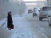 Passantin in der Innenstadt von Jakutsk. Jakutsk wurde 1632 gegruendet und feierte 2007 sein 375 jaehriges Bestehen. Jakutsk ist im Winter eine der kaeltesten Grossstaedte weltweit mit durchschnittlichen Winter Temperaturen von -40.9 Grad Celsius. Die Stadt ist nicht weit entfernt von Oimjakon, dem Kaeltepol der bewohnten Gebiete der Erde.<br /> <br /> Passerby in the city center of Yakutsk. Yakutsk was founded in 1632 and celebrated 2007 the 375th anniversary. Yakutsk is a city in the Russian Far East, located about 4 degrees (450 km) below the Arctic Circle. It is the capital of the Sakha (Yakutia) Republic (formerly the Yakut Autonomous Soviet Socialist Republic), Russia and a major port on the Lena River. Yakutsk is one of the coldest cities on earth, with winter temperatures averaging -40.9 degrees Celsius.