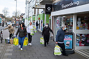 Local response to Coronavirus is felt on a street by street level as people wearing face masks carry their shopping bags outside Asda supermarket on Kings Heath High Street on 6th April 2020 in Birmingham, England, United Kingdom. Coronavirus or Covid-19 is a new respiratory illness that has not previously been seen in humans. While much or Europe has been placed into lockdown, the UK government has announced more stringent rules as part of their long term strategy, and in particular social distancing.