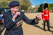Peter Kent, 90 Royal Navy, show off his boxing skills - Second World War Veterans, Reg Wilderspin (89) and John Cuthbert (92), and serving Guardsmen on Horse Guards Parade Ground to highlight Royal British Legion events on Victory in Europe (VE) Day. The Legion is also announcing that veterans and their carers will receive funding towards attending the event on the weekend of the 8-10th May.<br /> <br /> Places will be available for a series of commemorative events over the weekend including on VE Day itself, Friday 8 May, when a Service of Remembrance will be held at The Cenotaph, with a national two minute silence at 3pm. On Sunday 10 May, there will a Service of Thanksgiving at 11am at Westminster Abbey attended by HM The Queen, followed by a parade from the Abbey to Horse Guards Parade and into St James's Park, where the Legion will host a lunch reception for the veterans.