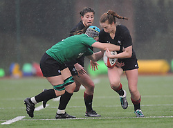 Ireland women's Anna Caplice tackles Wales women's Lisa Neumann<br /> <br /> Photographer Mike Jones/Replay Images<br /> <br /> International Friendly - Wales women v Ireland women - Sunday 21st January 2018 - CCB Centre for Sporting Excellence - Ystrad Mynach<br /> <br /> World Copyright © Replay Images . All rights reserved. info@replayimages.co.uk - http://replayimages.co.uk
