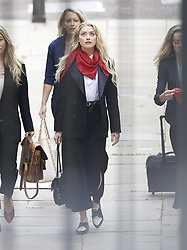 © Licensed to London News Pictures. 14/07/2020. London, UK. American actor AMBER HEARD arrives at the High Court in London where Johnny Depp is in a legal dispute with UK tabloid newspaper The Sun over allegations he assaulted his former wife, Amber Heard. Photo credit: Peter Macdiarmid/LNP