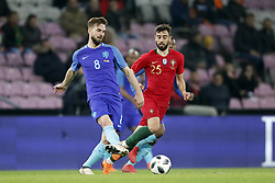 (L-R) Davy Propper of Holland, Bruno Fernandes of Portugal during the International friendly match match between Portugal and The Netherlands at Stade de Genève on March 26, 2018 in Geneva, Switzerland