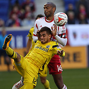 Hector Jimenez, Columbus Crew, clears in the penalty area while challenged by Thierry Henry, New York Red Bulls, during the New York Red Bulls Vs Columbus Crew, Major League Soccer regular season match at Red Bull Arena, Harrison, New Jersey. USA. 19th October 2014. Photo Tim Clayton