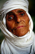 An old Yezidi woman near Mosul, Iraq<br /> The Yezidi are a mostly Kurdish speaking people's who's religion has long been seen, mistakenly, as having elements of devil worship. Their faith at times heavily persecuted in Iraq is highly synchretic and has elements of Sufistic Islam as well as Blblical and Persian influences.
