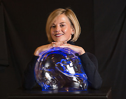 Pictured: Susie with the sculpture.<br /> <br /> A portrait in crystal of the unique helmet worn by Scottish F1 driver Susie Wolff MBE has been bought by the Scottish National Portrait Gallery in Edinburgh. The portrait, by artist Angela Palmer, goes on display next week.<br /> <br /> © Dave Johnston / EEm