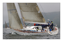 Yachting- The last days racing  of the Bell Lawrie Scottish series 2003 at Tarbert Loch Fyne.  Damp grey skies and light winds decided the final results in most fleets...Keith Miller's new Swan 45 ' Crackerjack'. ..Pics Marc Turner / PFM