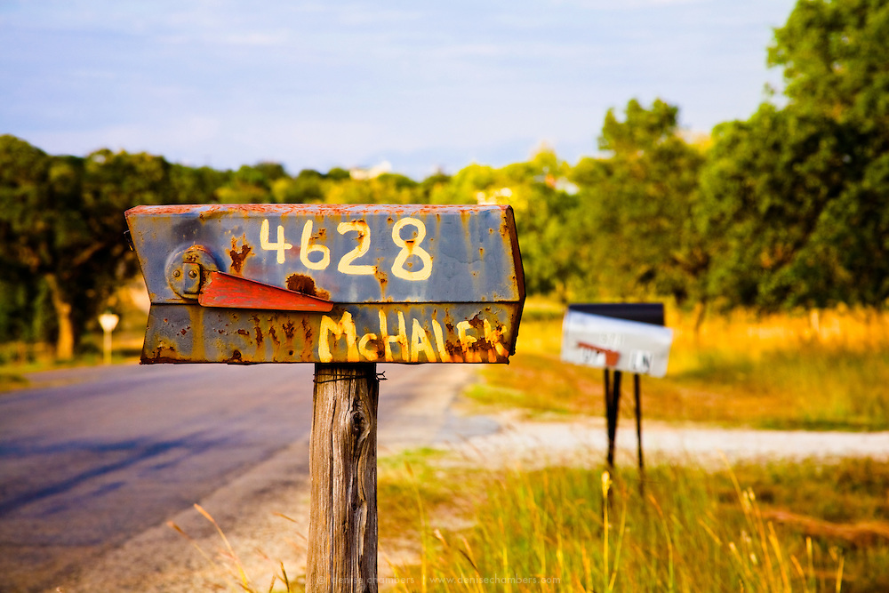 An old Rusted mailbox roadside in the Texas Hill Country