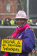 A rally organised against lockdown restrictions took place at Kings Cross Station in London, on Saturday Nov 28, 2020. A portrait of a  member of the public with a placard. (Photo: VXP /Erica Dezonne)