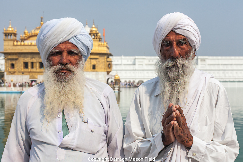 Two elderly Sikh pilgrims at the Golden Temple in Amritsar, India