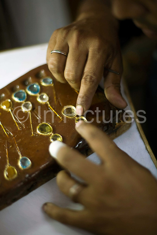 A worker making fine jewellery at the Gem Palace, Jaipur's foremost jewellers, Jaipur, India