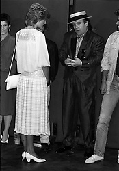 The Princess of Wales opened the Live Aid concert in aid of the African famine at Wembley Stadium, London. She is pictured here with Elton John, one of the many artistes appearing in the transatlantic event.