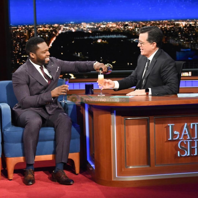 """50 Cent releases a photo on Instagram with the following caption: """"I had some Le Chemin du Roi (The King) on Stephen Colbert #1 night show. #bellator"""". Photo Credit: Instagram *** No USA Distribution *** For Editorial Use Only *** Not to be Published in Books or Photo Books ***  Please note: Fees charged by the agency are for the agency's services only, and do not, nor are they intended to, convey to the user any ownership of Copyright or License in the material. The agency does not claim any ownership including but not limited to Copyright or License in the attached material. By publishing this material you expressly agree to indemnify and to hold the agency and its directors, shareholders and employees harmless from any loss, claims, damages, demands, expenses (including legal fees), or any causes of action or allegation against the agency arising out of or connected in any way with publication of the material."""