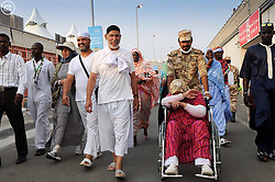 MECCA, Sept. 26, 2015 (Xinhua) -- Muslim pilgrims head to attend Hajj rituals in Mina outside Mecca, Saudi Arabia, Sept. 26, 2015. The death toll in Thursday's stampede in Mina, neighboring the holy city Mecca, has risen to 769, Saudi Health Minister Khalid al-Falih said on Saturday. The accident took place amid a rush of the stoning as part of Hajj rituals. Muslim pilgrims throw stones on a wall representing devil. .(Xinhua) (Credit Image: © Xinhua/Xinhua via ZUMA Wire)