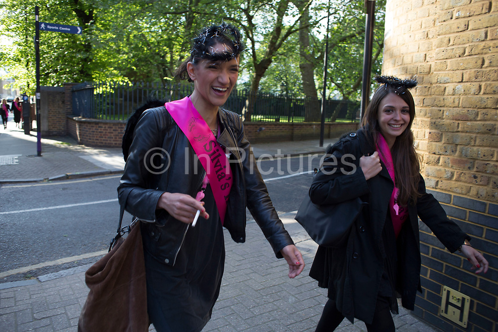 Hen party making their way along Wapping High Street for their big night in London, United Kingdom. A bachelorette party, hen party, hen night or hen do, is a party held for a woman who is about to get married. The terms hen party, hen do or hen night are common in the UK.