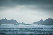 Looking over rough weather on sea in Mason Bay, The Southern Circuit, Stewart Island / Rakiura, New Zealand Ⓒ Davis Ulands | davisulands.com