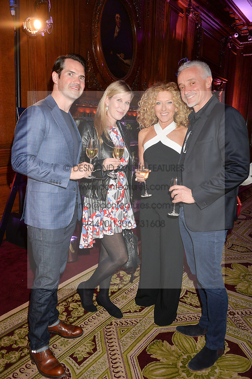 """Left to right, JIMMY CARR, KAROLINE COPPING, KELLY HOPPEN and JOHN GARDINER at the presentation of Le Prix Champagne De La Joie de Vivre to Stephen Webster in celebration of his long standing contribution to """"Joie de Vivre' held at the Council Room, One Great George Street, London on 22nd April 2015."""