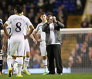 A pitch invader comes onto the pitch to have a selfie with Tottenham's Ben Davies<br /> <br /> Europa League Group C- Tottenham vs Partizan Belgrade - White Hart Lane - England - 27th November 2014 - Picture David Klein/Sportimage