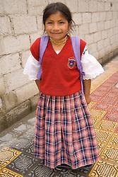 South America, Ecuador, Otavalo,  girl in school uniform walking home from school
