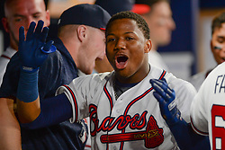 May 15, 2018 - Atlanta, GA, U.S. - ATLANTA, GA Ð MAY 15:  Braves rookie outfielder Ronald Acuna, Jr. (13) celebrates in the dugout after hitting a go-ahead home run in the 8th inning during the game between Atlanta and Chicago on May 15th, 2018 at SunTrust Park in Atlanta, GA. The Chicago Cubs defeated the Atlanta Braves by a score of 3 -2.  (Photo by Rich von Biberstein/Icon Sportswire) (Credit Image: © Rich Von Biberstein/Icon SMI via ZUMA Press)