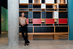 """© Licensed to London News Pictures. 17/06/2021. LONDON, UK. A model poses next to """"Air France London, shelving"""", 1957. Preview of """"Charlotte Perriand: The Modern Life"""" exhibition at the Design Museum in Kensington. Charlotte Perriand's (1903-1999) pioneering furniture designs shaped the 20th century and helped define the modern interior.  The exhibition marks the 25th anniversary of her first exhibition at the Design Museum in 1996 and runs 19 June to 5 September 2021.  Photo credit: Stephen Chung/LNP"""