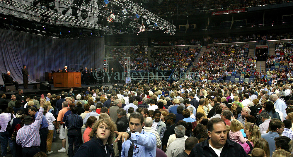 12 March 2006. New Orleans, Louisiana. <br /> Praising the Lord. A capacity crowd mingles with counselors in front of the pulpit at the last appearance from the Rev Billy Graham. Claiming this to be his last event preaching from the pulpit, the world's most famous evangelist, The Reverend Billy Graham addressed a capacity crowd at the New Orleans Arena as he brings his 'Celebration of Hope' weekend event to an end. After the show the counselors invite as many people as possible to invite Jesus into their hearts to be 'saved.' Proselytizing is intense.