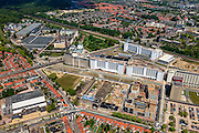 Nederland, Noord-Brabant, Eindhoven, 27-05-2013; Strijp-S, voormalige Philipsterrein, was niet toegankelijk voor het publiek, 'de verboden stad'. Het gebied, met diverse Rijksmonumenten, wordt ontwikkeld voor wonen, werken en cultuur.<br /> <br /> Boven in beeld Philitefabriek met Klokgebouw (Strijp S), in het midden het Veemgebouw met daar direct naast De Hoge (Witte) Rug. Meer onder in beeld, in baksteen het voormalige NatLab. <br /> <br /> Strijp-S, former Philips area, was not accessible to the public, 'the forbidden city'. The area, with several national monuments, is designated for living, working and culture.<br /> <br /> Top image Philitefabriek / Clock Building (Strijp S), in the middle of the Veemgebouw next to the High (White) Back. Bottom in the former NatLab (brick building). <br /> <br /> luchtfoto (toeslag op standard tarieven);<br /> aerial photo (additional fee required);<br /> copyright foto/photo Siebe Swart