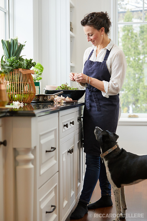 Chef/Caterer of Zoe Ford Catering, Joanna Notkin in the kitchen with a dog