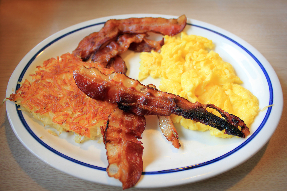 Breakfast. Bacon and eggs with hash browns
