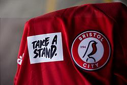 The 'Take A Stand' logo on the Bristol City Women shirt prior to kick off  - Mandatory by-line: Ryan Hiscott/JMP - 13/12/2020 - FOOTBALL - Twerton Park - Bath, England - Bristol City Women v West Ham United Women - Barclays FA Women's Super League