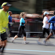 A blur of motion as runners make their way along First Avenue in Manhattan, New York, during the ING New York Marathon. New York, USA. 3rd November 2013. Photo Tim Clayton