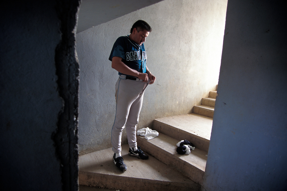 MINATITLAN, MEXICO:  The lack of a locker room for dressing forces a Saltillo Sarapero player to dress in a hallway leading to the field.